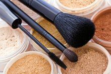 Cosmetic powders and brushes