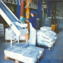 sack manipulator to belt conveyor automatic sack opening systems